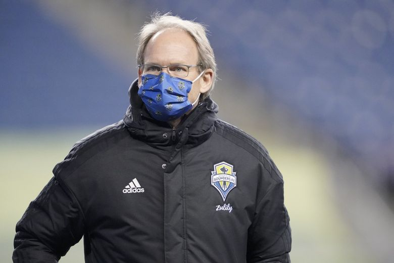 Seattle Sounders head coach Brian Schmetzer walks on the field before an MLS playoff soccer match against FC Dallas, Tuesday, Dec. 1, 2020, in Seattle.  (Ted S. Warren / AP)