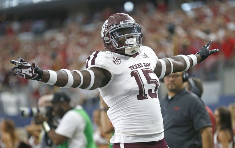 Texas A&M defensive lineman Jeremiah Martin (15) celebrates after Arkansas failed to convert on fourth down during the second half of an NCAA college football game Saturday, Sept. 28, 2019, in Arlington, Texas. (Ron Jenkins / AP)