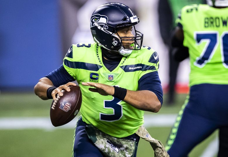 Seahawks quarterback Russell Wilson looks to throw in the first half as the Seattle Seahawks take on the Arizona Cardinals for Thursday Night Football at Lumen Field in Seattle Thursday November 19, 2020. 215694 (Bettina Hansen / The Seattle Times)