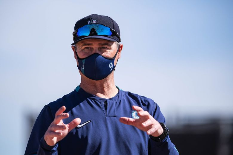 Manager Scott Servais talks to reporters just off the field Tuesday.  The Seattle Mariners opened Spring Training for the first full-squad workout Tuesday, February 23, 2021 In Peoria, AZ.  (Dean Rutz / The Seattle Times)