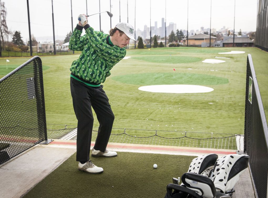 Seattle rapper Macklemore, who's become obsessed with golf lately, hits a golf ball at Jefferson Park driving range on Feb. 18. (Amanda Snyder / The Seattle Times)