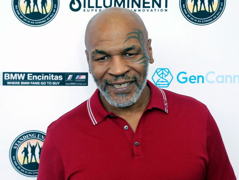 """FILE – In this Aug. 2, 2019, file photo, Mike Tyson attends a celebrity golf tournament in Dana Point, Calif. Hulu on Thursday, Feb. 25, 2021, announced it has ordered """"Iron Mike,"""" a limited series about the life of boxing great Mike Tyson. (Photo by Willy Sanjuan/Invision/AP, File)"""