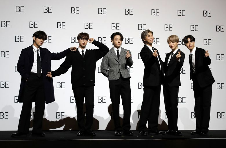 """File—File photo taken Nov.20, 2020 members of South Korean K-pop band BTS pose for photographers during a press conference to introduce their new album """"BE"""" in Seoul, South Korea. (AP Photo/Lee Jin-Man, file)"""