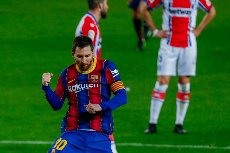Barcelona's Lionel Messi celebrates after scoring his side's second goal during the Spanish La Liga soccer match between FC Barcelona and Alaves at the Camp Nou stadium in Barcelona, Spain, Saturday, Feb. 13, 2021. (AP Photo/Joan Monfort)