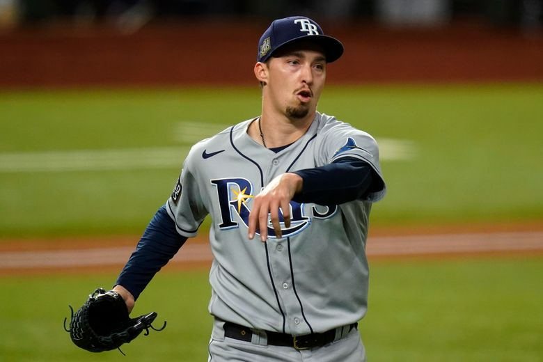 FILE – In this Oct. 27, 2020, file photo, Tampa Bay Rays starting pitcher Blake Snell celebrates the end of the fifth inning against the Los Angeles Dodgers in Game 6 of the baseball World Series in Arlington, Texas. Snell can't wait to face the Los Angeles Dodgers again, and as often as possible. He'll get plenty of chances now that he's with the San Diego Padres, who in the span of a few weeks in the offseason remade their roster into one they believe can contend for the World Series title. (AP Photo/Eric Gay, File)