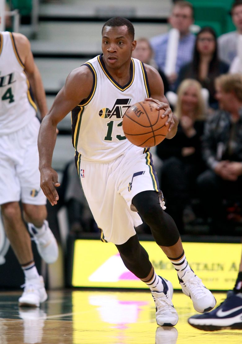 FILE – In this Nov. 23, 2015, file photo, Utah Jazz guard Elijah Millsap brings the ball downcourt against the Oklahoma Thunder in the second half during an NBA basketball game in Salt Lake City.  Former Jazz player Millsap alleged this week that Utah executive Dennis Lindsey made a bigoted comment to him in 2015. The Jazz and the NBA are investigating. (AP Photo/George Frey, File)
