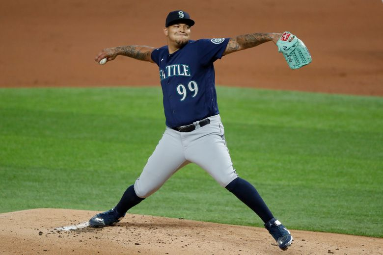 Taijuan Walker pitches for the Seattle Mariners in a game in 2020 while wearing #99. (Tony Gutierrez / AP, file)