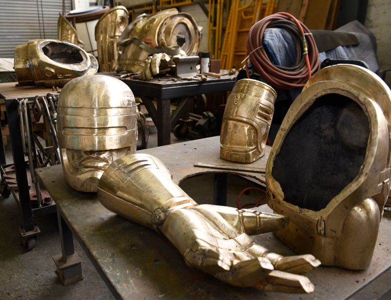 FILE – In this Sept. 19, 2017, file photo, body parts for a RoboCop statue are displayed in sculptor conservator Giorgio Gikas' studio in Detroit. The Detroit News reports that the Michigan Science Center announced Wednesday, Feb. 24, 2021, that it no longer plans to be home to the 11-foot-tall bronze RoboCop statue. (Clarence Tabb Jr./Detroit News via AP, File)