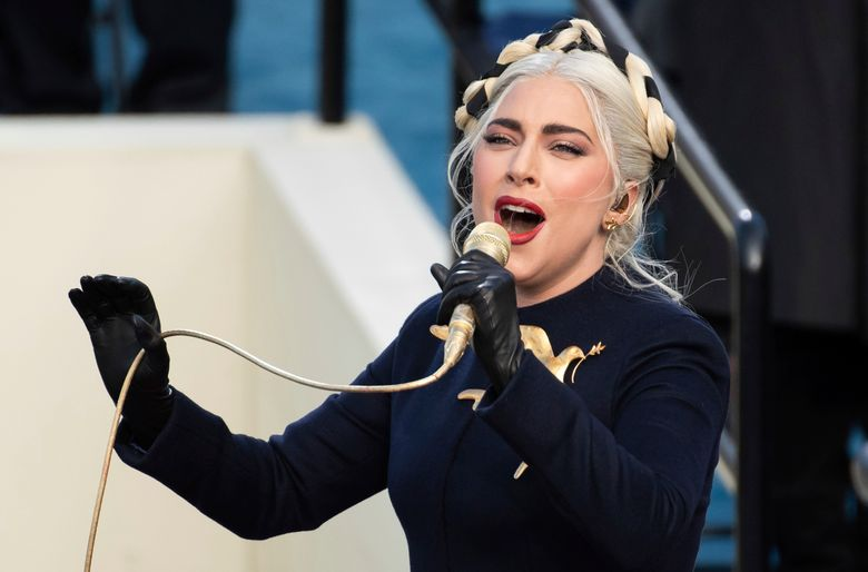 FILE – In this Wednesday, Jan. 20, 2021 file photo, Lady Gaga sings the national anthem during President-elect Joe Biden's inauguration at the U.S. Capitol in Washington. Lady Gaga's two French bulldogs, which were stolen by thieves who shot and wounded the dogwalker, were recovered unharmed Friday, Feb. 26, 2021 Los Angeles police said.(AP Photo/Saul Loeb, Pool)