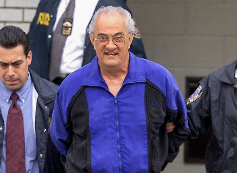 FILE – In this June 4, 2002, file photo, Peter Gotti, center, is escorted out of the Waterfront Commission following his arrest in the Brooklyn borough of New York. Gotti, the brother of notorious Gambino crime boss John Gotti, has died while serving a federal prison sentence, a person familiar with the matter told The Associated Press on Thursday, Feb. 25, 2021. Gotti, 81, died of natural causes while incarcerated at the Federal Medical Center in Butner, N.C., said the person, who could not discuss the matter publicly and spoke to the AP on condition of anonymity. (Mike Albans/The Daily News via AP, File)