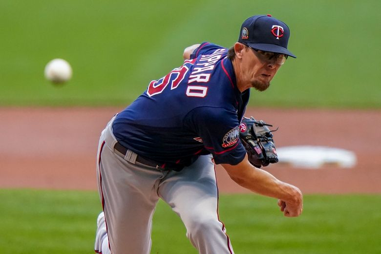 FILE – In this Aug. 11, 2020, file photo, Minnesota Twins' Tyler Clippard throws during the first inning of a baseball game against the Milwaukee Brewers in Milwaukee. The Arizona Diamondbacks have agreed to a $2.25 million, one-year contract with Clippard, a person with knowledge of the negotiations told The Associated Press. The agreement was reached on Monday, Feb. 22, 2021, and confirmed to the AP on condition of anonymity because the deal is pending a physical. (AP Photo/Morry Gash, File)