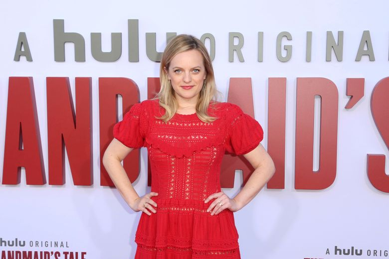 """FILE – In this Tuesday, Aug. 6, 2019, file photo, Elisabeth Moss attends the """"The Handmaid's Tale"""" season three finale red carpet at the Regency Village Theatre, in Los Angeles. The drama series' fourth season begins April 28, 2021, and will include 10 episodes. (Photo by Willy Sanjuan/Invision/AP, File)"""
