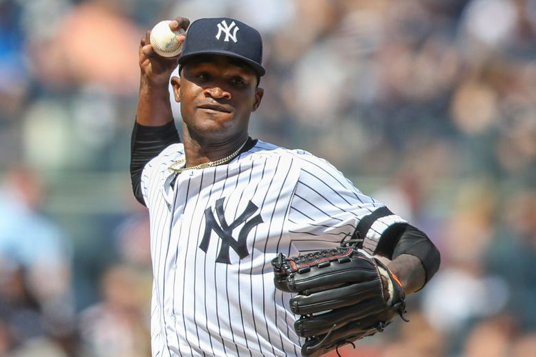 FILE – In this Aug. 31, 2019, file photo, New York Yankees pitcher Domingo German throws to first in a pickoff-attempt during the fifth inning of a baseball game against the Oakland Athletics in New York. German has started the process of talking to teammates about his domestic violence suspension that has kept him off the mound since September 2019. (AP Photo/Mary Altaffer, File)