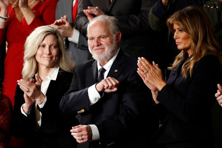 Rush Limbaugh reacts in 2020 as first Lady Melania Trump and his wife Kathryn, applaud, while then-President Donald Trump delivers his State of the Union address.  Limbaugh, the talk radio host who became the voice of American conservatism, has died. (AP Photo/Patrick Semansky, File)