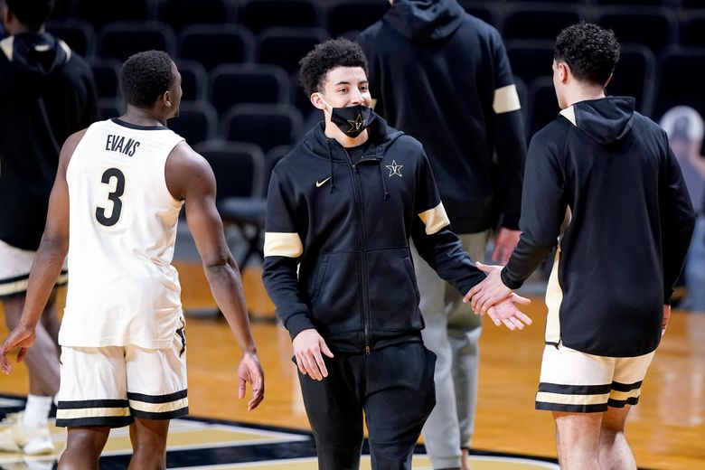 Vanderbilt's Scotty Pippen Jr., center, greets teammates before an NCAA college basketball game Wednesday, Feb. 24, 2021, in Nashville, Tenn. Pippen did not warm up with the team. Pippen is the SEC's second-leading scorer averaging 20.5 points a game and had started every game this season. This snaps a 32-game start streak. (AP Photo/Mark Humphrey)
