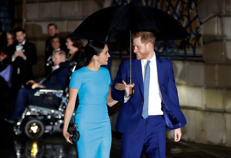 FILE – In this Thursday, March 5, 2020, file photo, Britain's Prince Harry and Meghan arrive at the annual Endeavour Fund Awards in London. The Duke and Duchess of Sussex's foundation has helped support the completion of an emergency relief center in the Commonwealth. World Central Kitchen announced Wednesday, Feb. 24, 2021, that the construction of the first community relief center in Dominica has been completed. (AP Photo/Kirsty Wigglesworth, File)