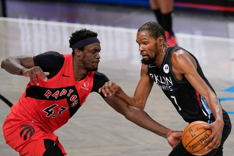 Toronto Raptors' Pascal Siakam (43) defends against Brooklyn Nets' Kevin Durant (7) during the first half of an NBA basketball game Friday, Feb. 5, 2021, in New York. (AP Photo/Frank Franklin II)
