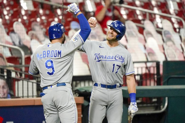 Kansas City Royals' Hunter Dozier celebrates with teammate Ryan McBroom (9) during a game against the St. Louis Cardinals last season in St. Louis. Jeff Roberson / AP, file)