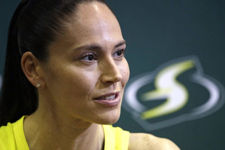 In this Monday, May 13, 2019, file photo, Seattle Storm's Sue Bird talks with media members at the basketball team's media day in Seattle. (Elaine Thompson / AP)