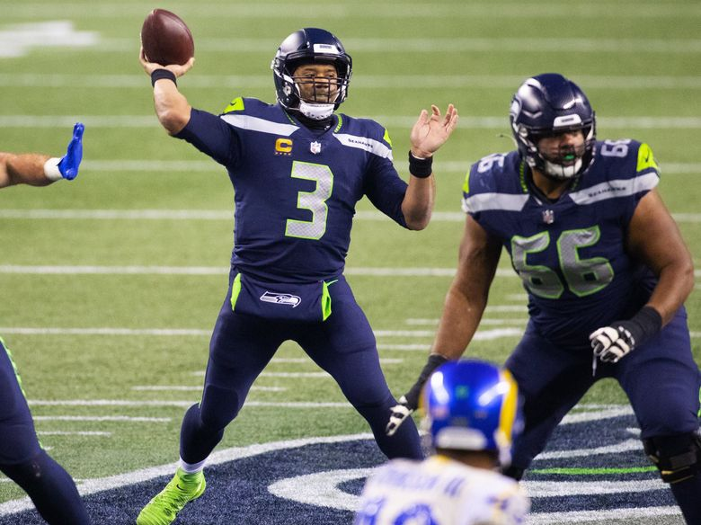 Seattle Seahawks quarterback Russell Wilson (3) makes a 2nd quarter pass as the Los Angeles Rams play the Seattle Seahawks at Lumen Field in Seattle on January 9, 2021. Seattle Seahawks offensive guard Jordan Simmons (66) is at right.  216070 (Mike Siegel / The Seattle Times)