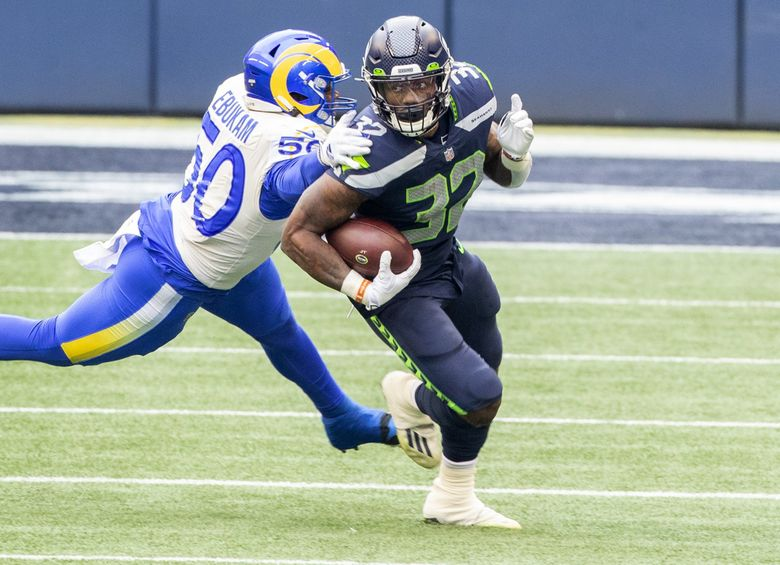Seattle Seahawks running back Chris Carson (32) and the Seattle Seahawks had very few long runs as the Los Angeles Rams play the Seattle Seahawks at Lumen Field in Seattle on January 9, 2021.  (Mike Siegel / The Seattle Times)