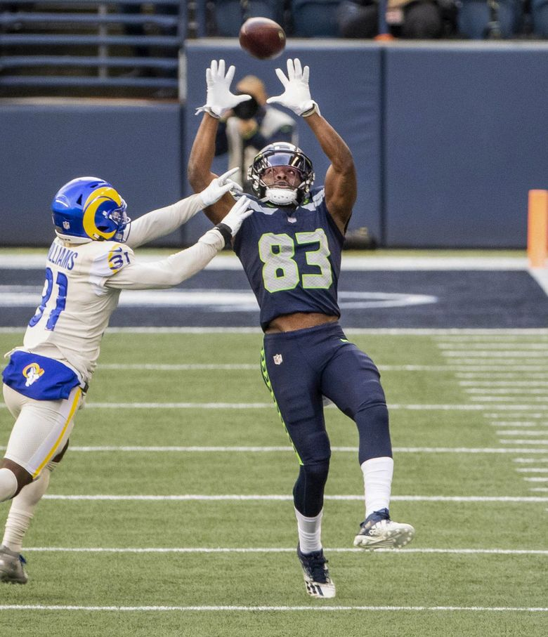 David Moore's 45-yard reception – beating Rams cornerback Darious Williams- set up the Seahawks first touchdown in the 3rd quarter.  The Los Angeles Rams played the Seattle Seahawks in a game that will determine the winner of the NFC West Sunday, December 27, 2020 at Lumen Field in Seattle, WA.  (Dean Rutz / The Seattle Times)