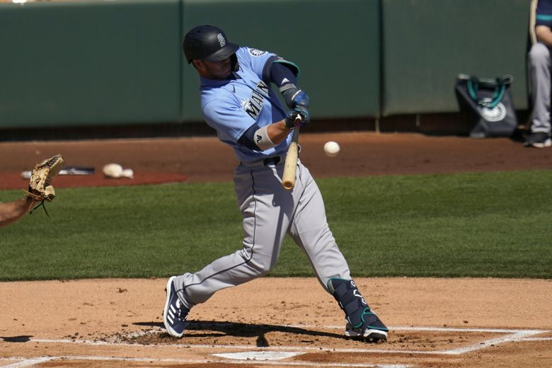 Seattle Mariners' Ty France connects for a run-scoring single against the Chicago White Sox during the first inning of a spring training baseball game Friday, March 5, 2021, in Phoenix. (AP Photo/Ross D. Franklin) AZRF105 AZRF105 (Ross D. Franklin / The Associated Press)