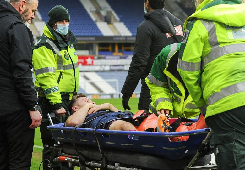 Jordan Morris of Swansea City is taken of the field on a stretcher during the Sky Bet Championship match between Huddersfield Town and Swansea City at The John Smith's Stadium on February 20, 2021 in Huddersfield, England.  (Athena Pictures / Getty Images)
