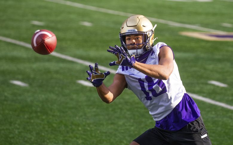 Husky wide receiver Rome Odunze works out as the Washington Huskies practice at Husky Stadium on Oct. 9, 2020. (Mike Siegel / The Seattle Times)