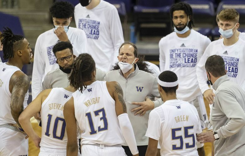 Mike Hopkins draws his team in during a timeout against the Arizona Wildcats on Dec. 31, 2020. (Dean Rutz / The Seattle Times)