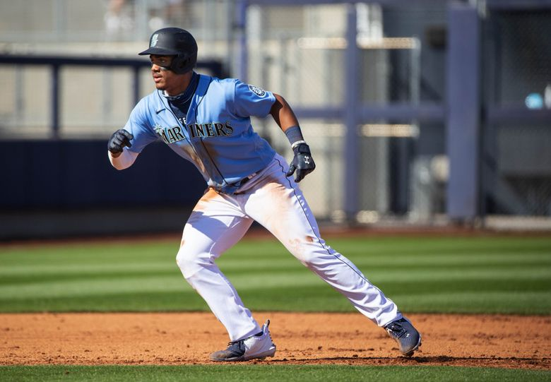 Julio Rodriguez leads off from second base in a spring game against Colorado on Thursday, March 2, 2021 in Peoria, AZ. (Dean Rutz / The Seattle Times)