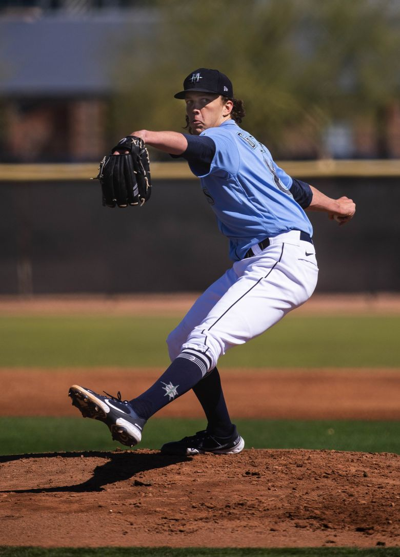 Logan Gilbert throws to live hitters last month at Mariners spring training in Peoria, Arizona. (Dean Rutz / The Seattle Times)
