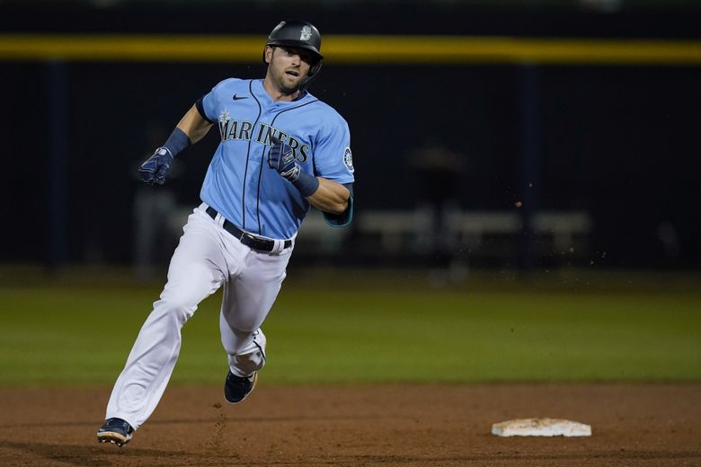 Seattle Mariners' Mitch Haniger runs past second base with a stand-up triple during the sixth inning of a spring training game against the Chicago White Sox on Friday. (Sue Ogrocki / The Associated Press)