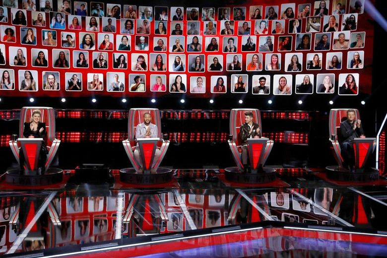 """Coaches (from left) Kelly Clarkson, John Legend, Nick Jonas and Blake Shelton pick their teams for """"The Voice."""" Kelly Clarkson chose two Seattle-area singers, Halley Greg and  Savanna Woods, for her team this season. (Trae Patton / NBC)"""
