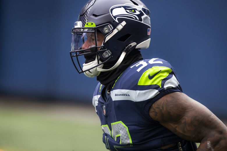 SEAHAWKS FILE —  Seahawks running back Chris Carson warms up before the Seattle Seahawks take on the New York Jets at Lumen Field in Seattle Sunday December 13, 2020. 215892 (Bettina Hansen / The Seattle Times)