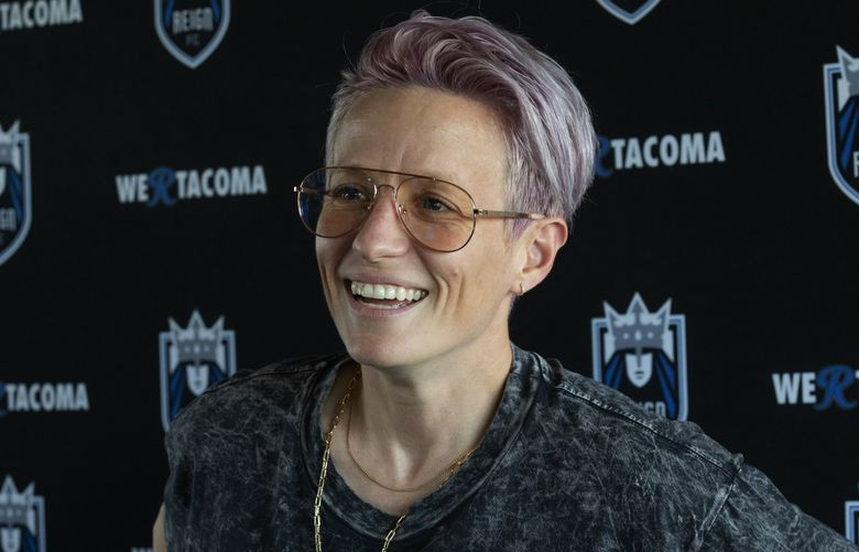 Megan Rapinoe, a member of the U.S. women's national soccer team and the Reign FC,  smiles after a press conference at Cheney Stadium in Tacoma Wednesday, July 24, 2019.  (Ellen M. Banner / The Seattle Times)