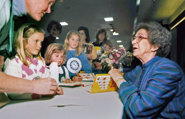 Beverly Cleary signs books at the Monterey Bay Book Festival in Monterey, California, in 1998. The beloved children's book author died March 25 at age 104. (Vern Fisher / The Associated Press, file)