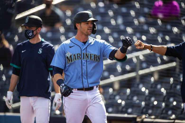 Mitch Haniger lead off the hit parade in the 3rd with a 3-run homer to left.  The Colorado Rockies and Seattle Mariners played to a 9-9 tie Thursday, March 2, 2021 in Spring Training baseball in Peoria, AZ. (Dean Rutz / The Seattle Times)