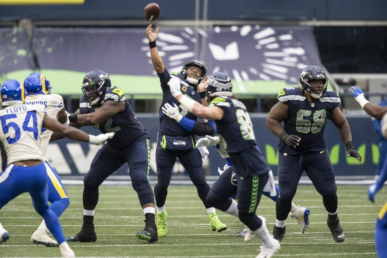 Russell Wilson lofts a deep ball intended for Dk Metcalf that misses its mark in the 3rd quarter.  The Los Angeles Rams played the Seattle Seahawks in the Wild Card round of the NFL Playoffs Saturday, January 9, 2021 at Lumen Field in Seattle, WA. 216064 (Dean Rutz / The Seattle Times)