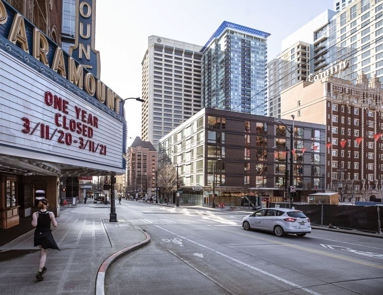The Paramount Theatre marquee on March 11 reflects the pandemic-mandated closures of the past year. (Steve Ringman / The Seattle Times)