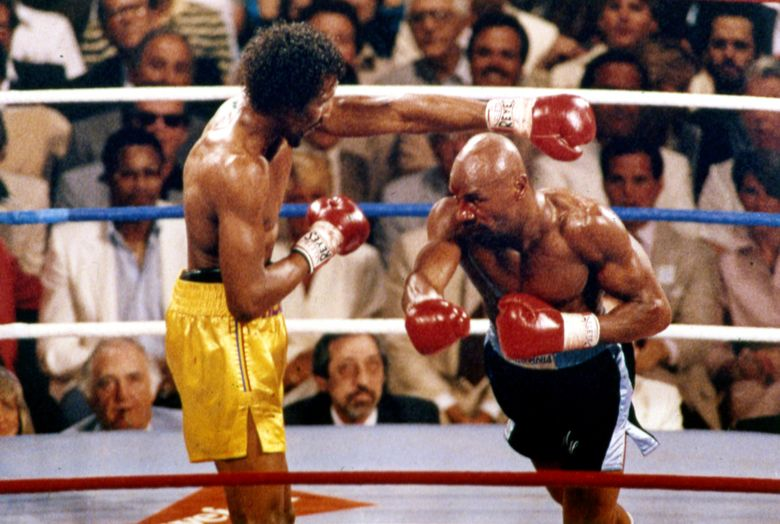 Marvin Hagler, right, and Thomas Hearns fight during the first round of a world-championship boxing bout in Las Vegas in 1985. (AP, 1985)