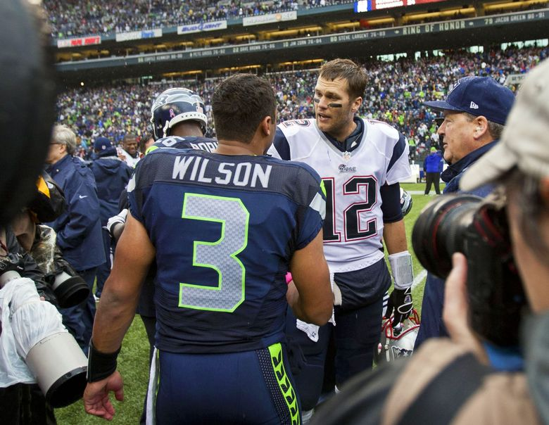 Quarterbacks Russell Wilson of Seattle and Tom Brady of New England meet midfield following the Seahawks' 24-23 come-from-behind win over the Patriots Sunday, Oct. 14, 2012. (Dean Rutz / The Seattle Times)