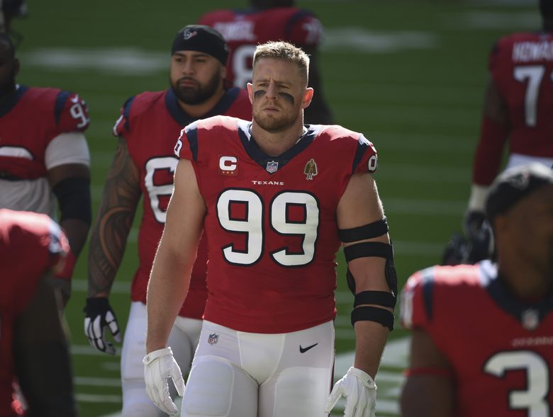 Houston Texans defensive end J.J. Watt (99) walks with teammates before an NFL football game against the Indianapolis Colts, Sunday, Dec. 6, 2020, in Houston. Watt signed with the Arizona Cardinals Monday, March 1, 2021. (Eric Christian Smith / AP)