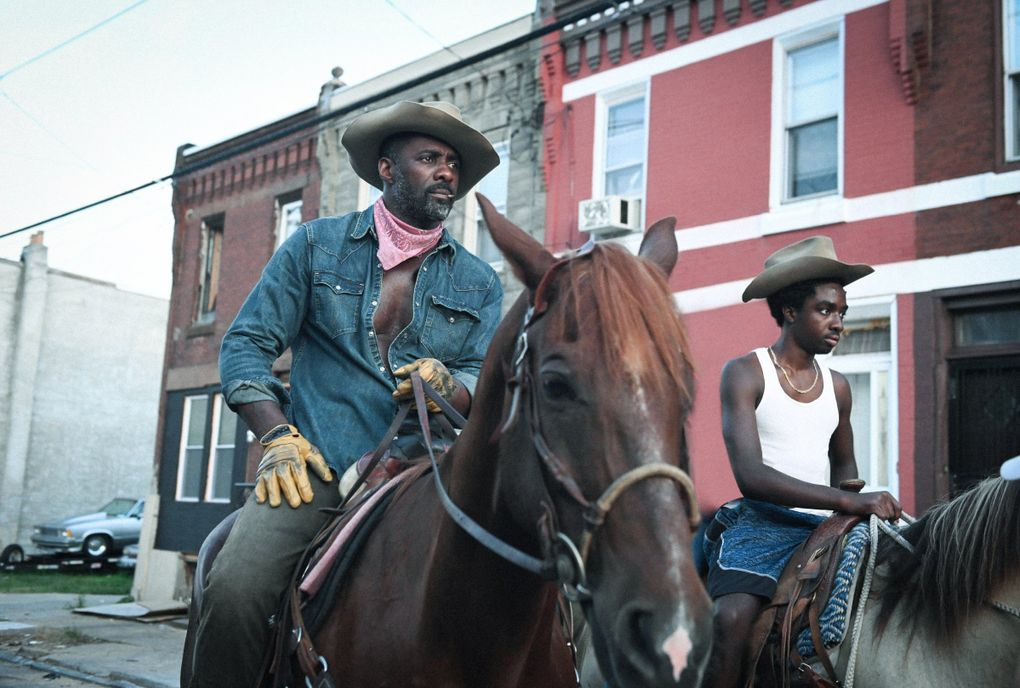 """Idris Elba and Caleb McLaughlin play father and son in """"Concrete Cowboy."""" (Netflix)"""