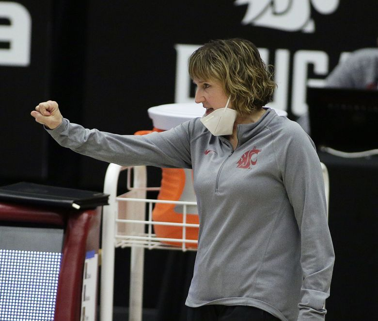 Washington State head coach Kamie Ethridge signals her team during the first half of an NCAA college basketball game against UCLA in Pullman, Wash., Friday, Feb. 5, 2021.  (Young Kwak / AP)