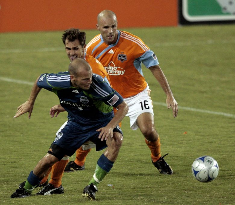 Seattle's Freddie Ljungberg keeps the ball away from Houston Dynamo's Brad Davis and Craig Waibel during a soccer game Saturday, August 23, 2008 at Robertson Stadium in Houston. (Bob Levey / AP)