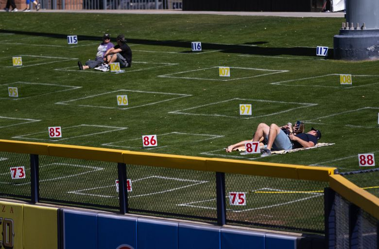 To ensure social distancing the outfield lawn is sectioned off for fans.  The Cleveland Indians played the Seattle Mariners in Spring Training baseball Tuesday, March 2, 2021 at the Peoria Sports Complex in Peoria, AZ. 216537 (Dean Rutz / The Seattle Times)
