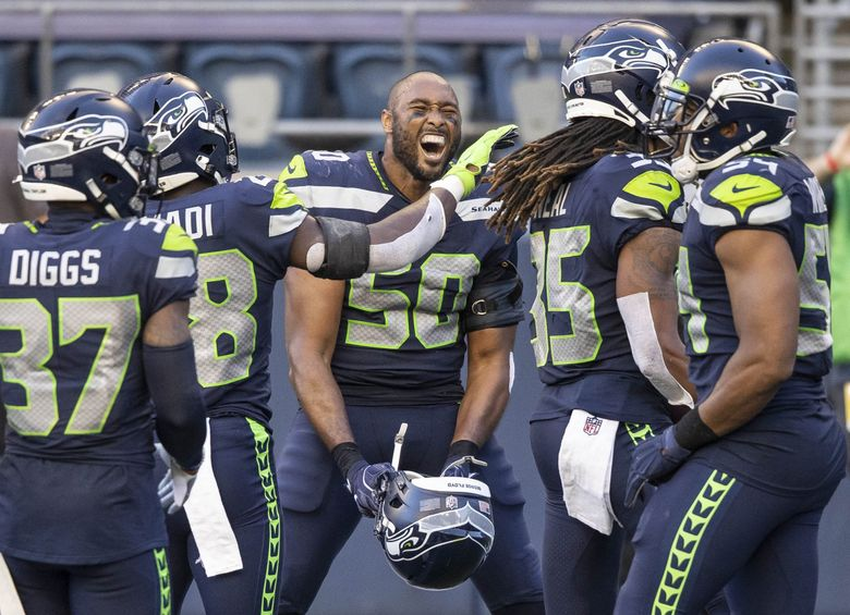 K.J. Wright (center) and the Seahawks secondary celebrate safety Ryan Neal (35) whose interception of the Dak Prescott pass on the Cowboys' final play sealed the win for the Seahawks on Sunday, Sept. 27, 2020 at CenturyLink Field in Seattle, Washington. (Dean Rutz / The Seattle Times)