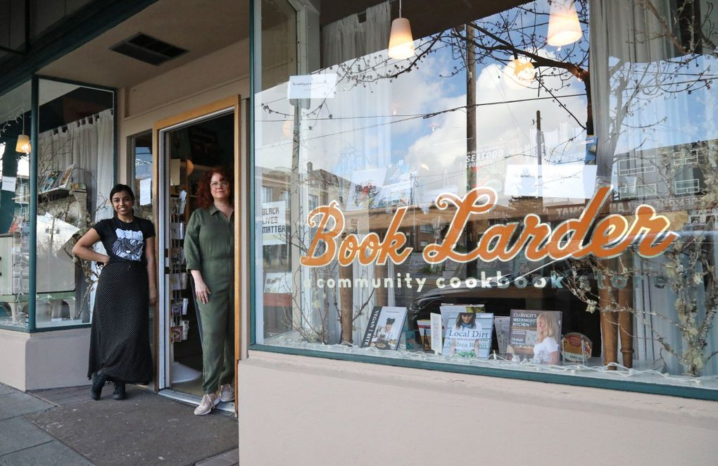 Book Larder bookstore is celebrating a decade of cookbooks on Fremont Avenue North. At left is Meghna Jaradi, Book Larder events manager, and founder Lara Hamilton. (Greg Gilbert / The Seattle Times)