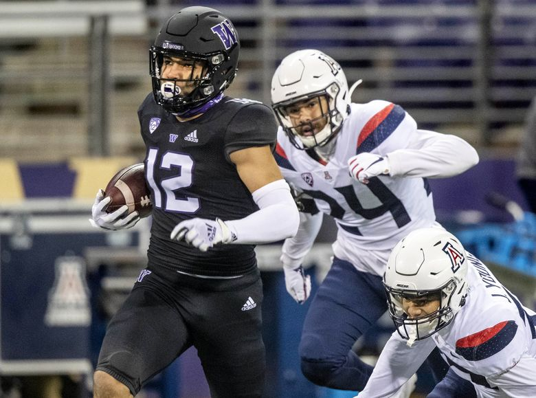 On 3rd and 10, Puca Nacua goes for 65 yards for a touchdown on a Dylan Morris pass in the 1st quarter. The University of Arizona Wildcats played the University of Washington Huskies in Pac-12 football Saturday, November 21, 2020 at Husky Stadium in Seattle, WA. (Dean Rutz / The Seattle Times)